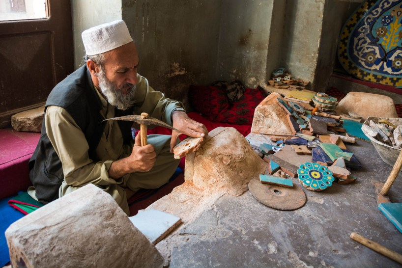 A tile maker chipping away at the Jame Mosque in Herat, Afghanistan - Lost With Purpose