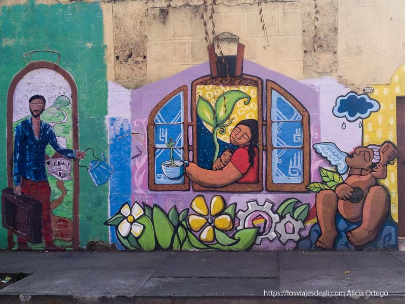 streetart colorido con dibujos de indígenas en las calles del barrio brasil de santiago de chile