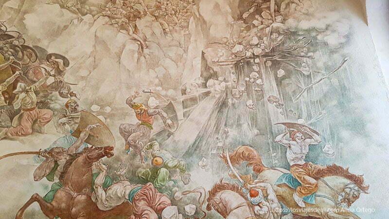 mural donde se ve al ejército de Skanderberg lanzar piedras a los turcos desde una montaña