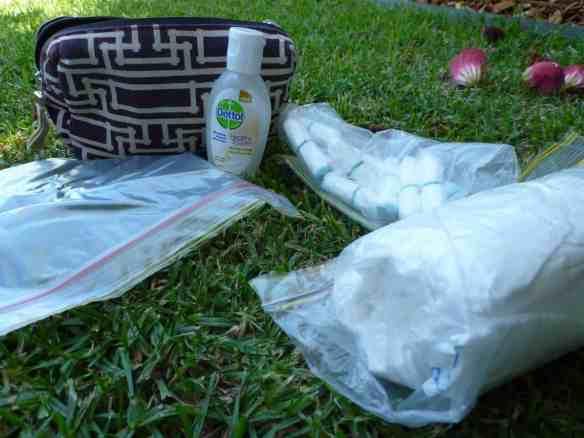 Ziploc bags, toilet paper, tampons, hand sanitiser & my discreet Qantas baggie to keep it all in.