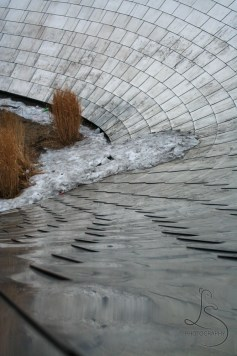 Ice collected at the bottom of a metallic slope in Millenium Park in Chicago | LotsaSmiles Photography