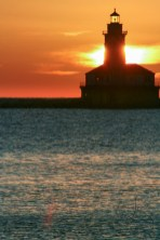 Chicago Harbor Lighthouse silhouetted in front of the sunrise | LotsaSmiles Photography