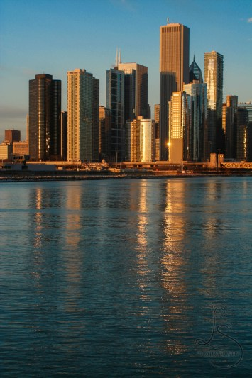 Chicago skyline reflected in the bay at sunrise | LotsaSmiles Photography