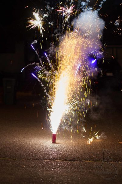 A simple rocket firework exploding from the ground | LotsaSmiles Photography