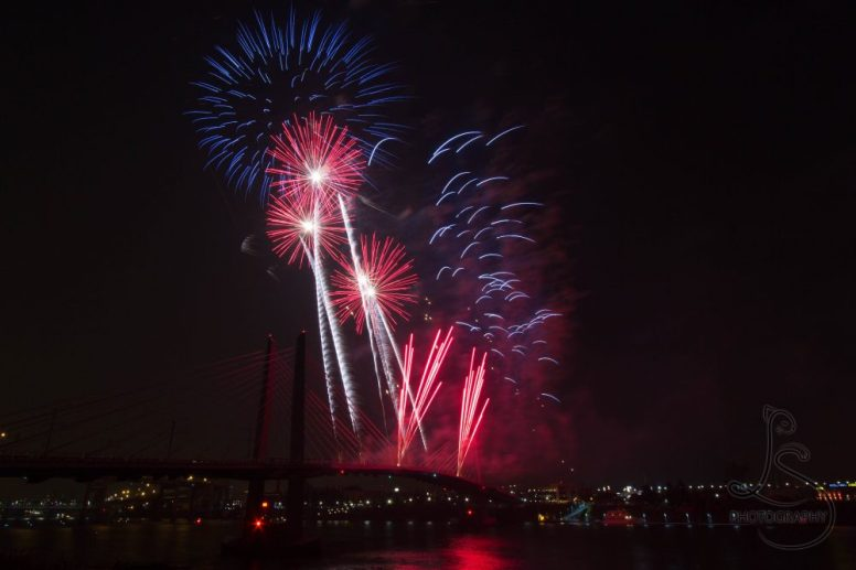 Red fireworks over Portland's Tilikum Crossing | LotsaSmiles Photography