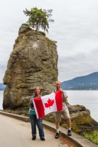 Aaron and me holding a Canadian flag in Stanley Park | LotsaSmiles Photography