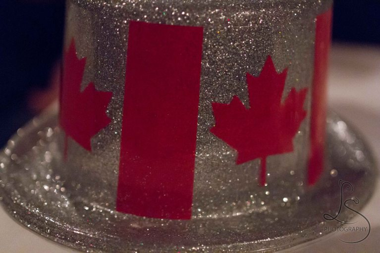A sparkly plastic Canadian flag hat | LotsaSmiles Photography