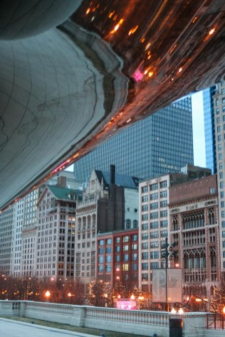 Looking out from under The Bean at the buildings of Chicago | LotsaSmiles Photography