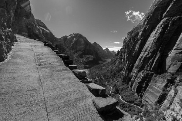 Ascending the paved Angels Landing trail, with the valley floor in the distance   LotsaSmiles Photography