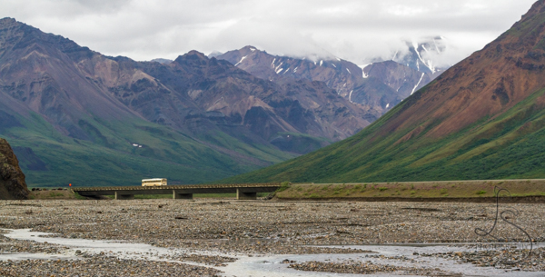 Shuttle bus crossing a river bridge in front of the misty mountains of Denali National Park   This Week On Instagram - LotsaSmiles Photography