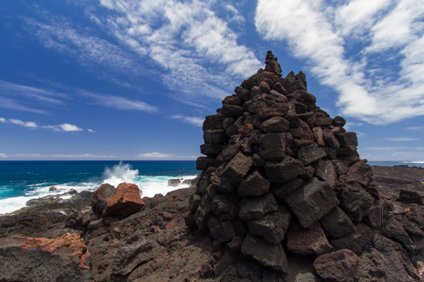 A towering pile of rocks at a Hawaiian beach | LotsaSmiles Photography
