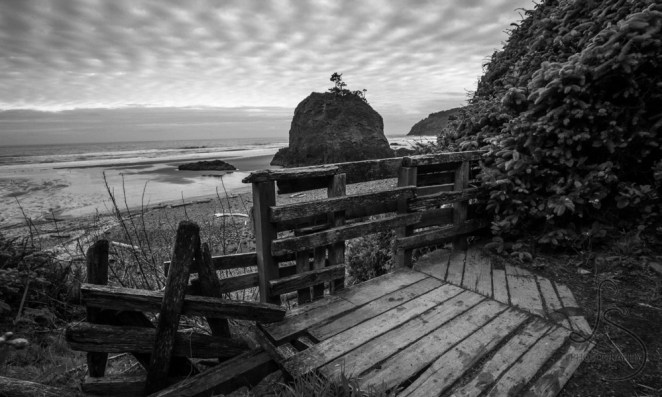 A small beach cove, dominated by a large boulder, under fish-scale clouds | LotsaSmiles Photography