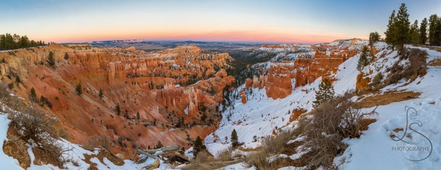 Sunset falls on Bryce Canyon National Park, highlighting the valley, only half still snow-covered