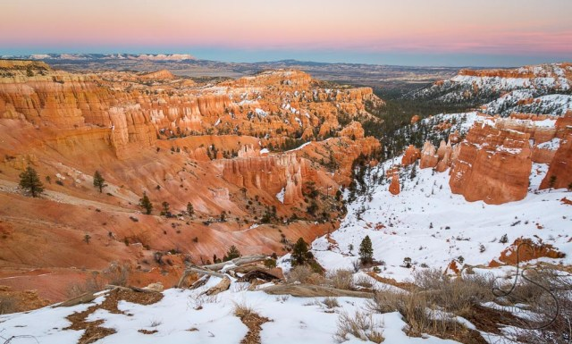 Bryce Canyon at dusk, with only half the landscape covered in snow | LotsaSmiles Photography