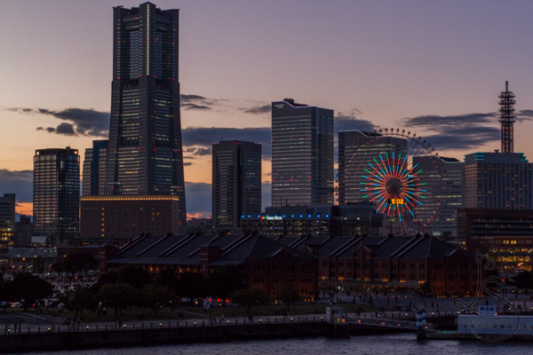 The Yokohama skyline just after sunset, with lights illuminated | LotsaSmiles Photography
