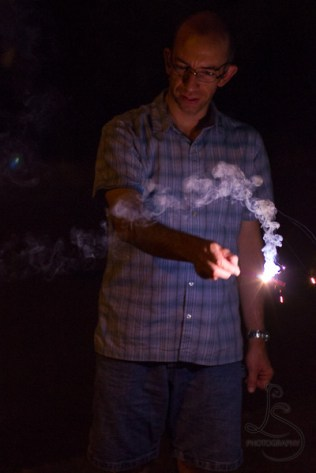 Aaron holding a sparkler | LotsaSmiles Photography