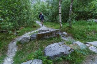 Aaron walking along the trail to Kjenndalen | LotsaSmiles Photography