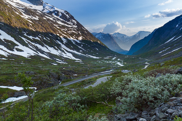 An evening view of a Norwegian road winding through the valley | LotsaSmiles Photography