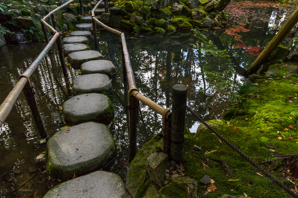 Stone path crossing a pond at a Kyoto temple | LotsaSmiles Photography