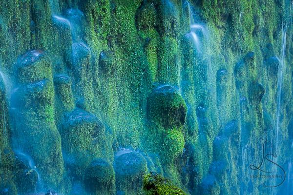 Mossy rocks behind a waterfall | LotsaSmiles Photography