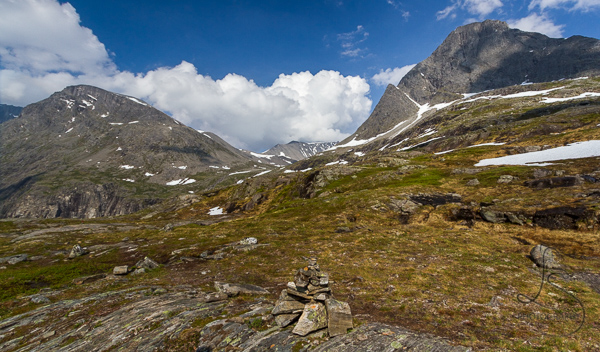 A cairn in front of a stunning Norwegian landscape above Trollstigen | LotsaSmiles Photography