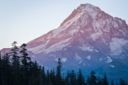 The tip of Mount Hood as awakens to the first rays of sunrise striking the peak