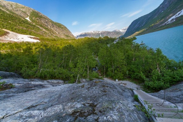 The fjord by the Nigardsbreen glacier, with steps afixed to the rocks to form the trail | LotsaSmiles Photography