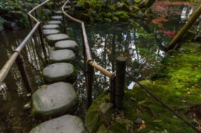A stone path leads across a serene pond at a temple in Kyoto, Japan. Anyone can find their inner peace in a quiet place like this.