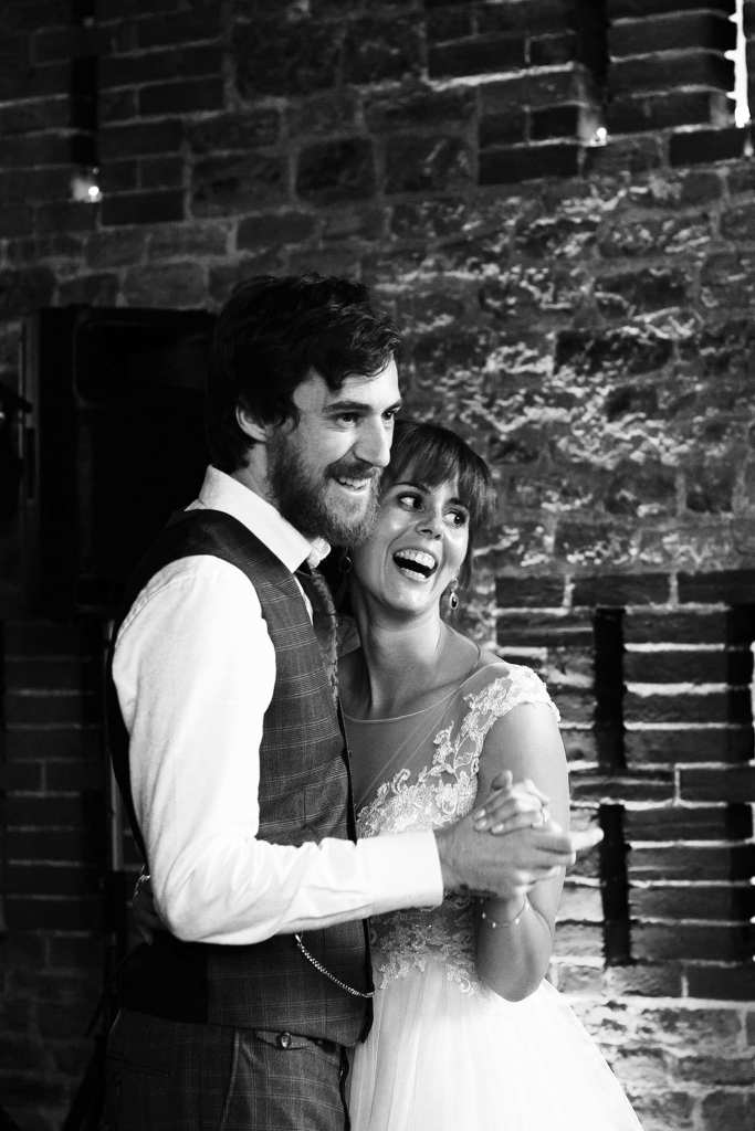 Wedding couple during their first dance in Bartholomew Barn  photographed by London based wedding and family photographer