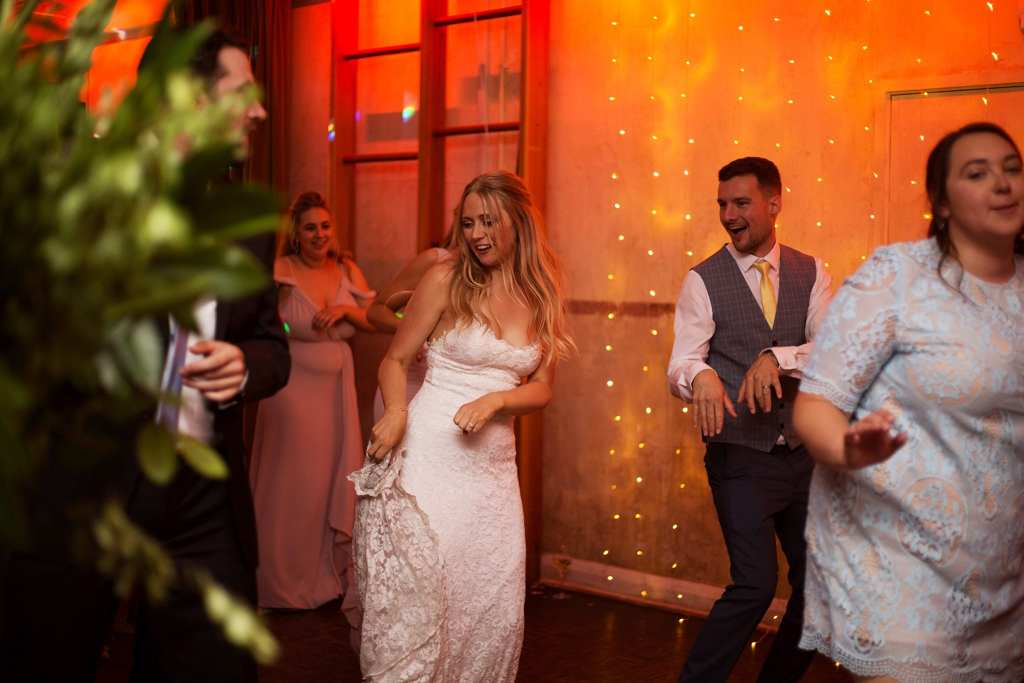 Bride and Groom dancing to Saturday night taken by London wedding photographer, Lottie Povall