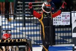 Kimi Raikkonen, Lotus F1, 1st position, celebrates on arrival in Parc Ferme.