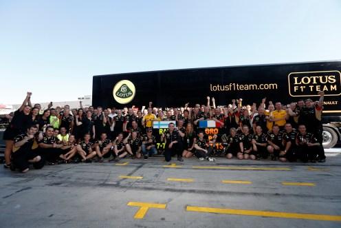 The Lotus F1 team celebrate a double podium finish