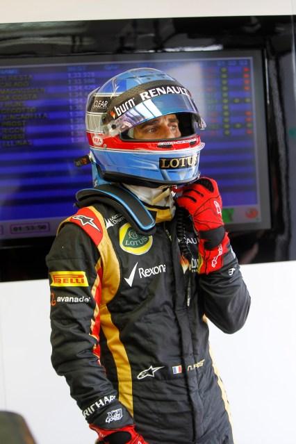 Silverstone, UK Wednesday 16th July 2013 Nicolas Prost, Development Driver, Lotus F1 puts on his helmet in the garage