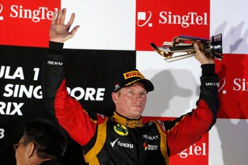 Kimi Raikkonen, Lotus F1 on the podium.