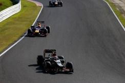 Romain Grosjean, Lotus E21 Renault, leads Mark Webber, Red Bull RB9 Renault, and Sebastian Vettel, Red Bull RB9