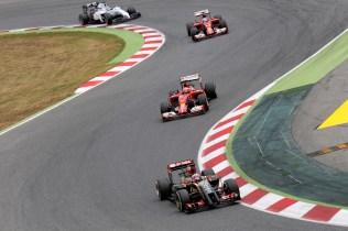 Romain Grosjean, Lotus E22 Renault, leads Kimi Raikkonen, Ferrari F14T, Fernando Alonso, Ferrari F14T, and Felipe Massa, Williams FW36 Mercedes.