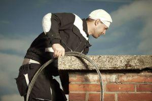 man sweeping chimney