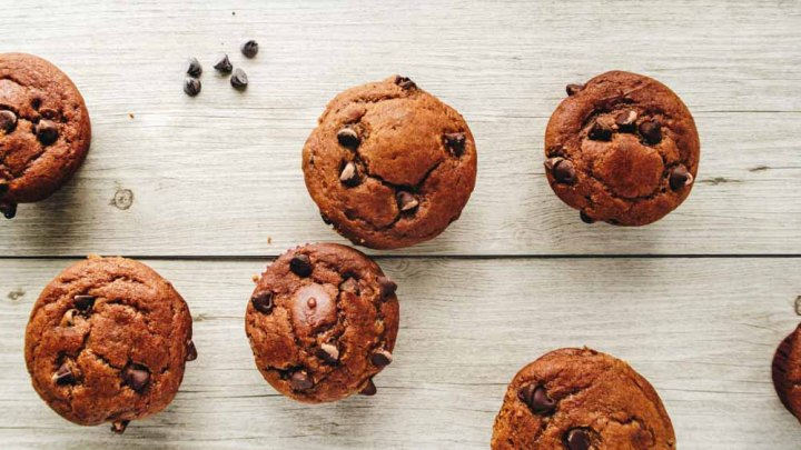 Top view of Vegan cannabis infused Pumpkin Muffins with Chocolate Chips on a wood background
