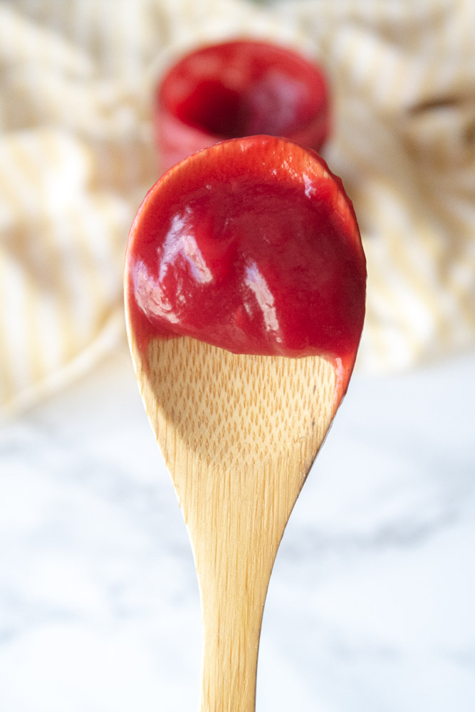 vegan raspberry curd on a spoon