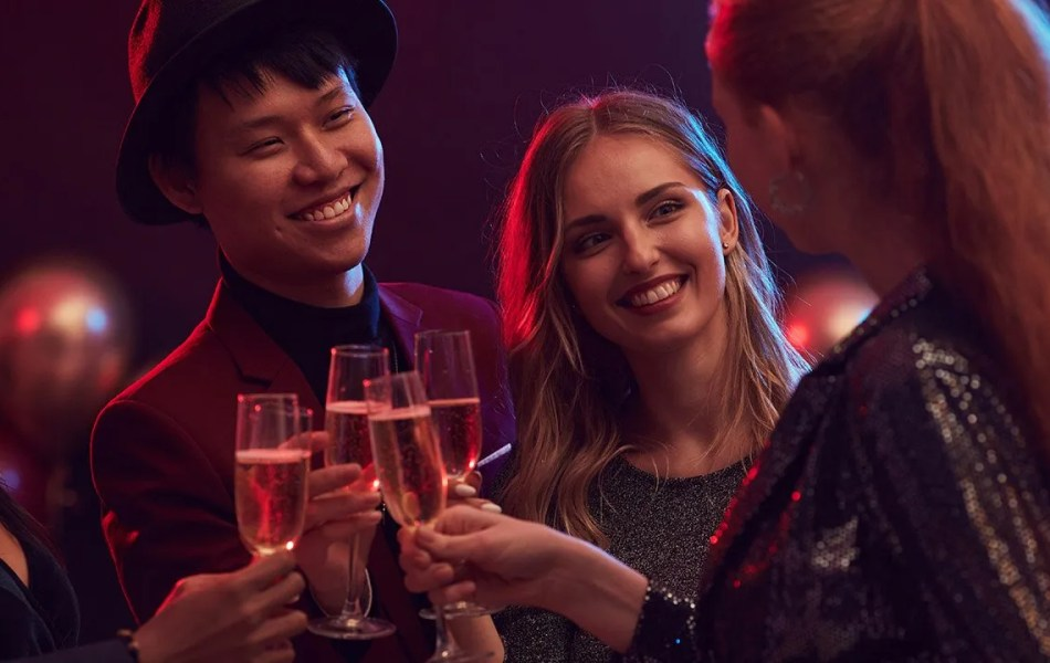 Young People toasting champagne at restaurant grand opening for restaurant video marketing