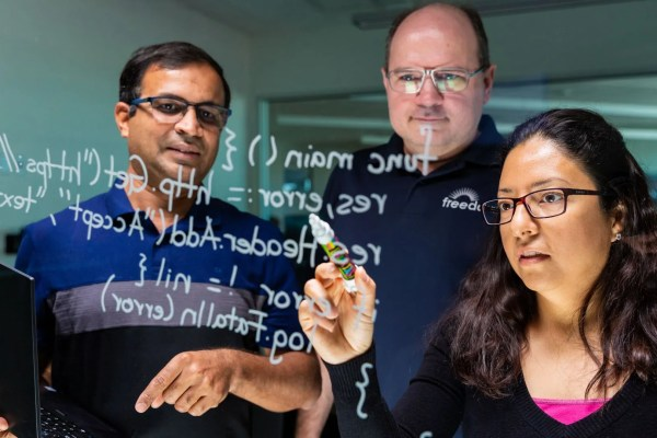 Video thumbnail of engineers writing code on glass