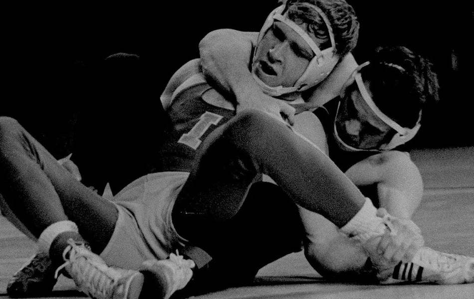 vintage black and white photo of two young greco roman wrestlers in action - promo video featured image to support the video produced by loudbyte