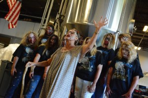 Aurora School Testing Coordinator Katie Loudermilk, as Mamaw Carver, leads a blessing of this year's Oxorcist Imperial Pumpkin Ale at Old Ox Brewery. [Renss Greene/Loudoun Now]