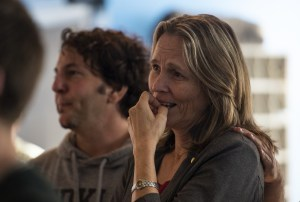 "Co-director Tom Sweitzer comforts Ann-Charlotte Robertson as she reacts to a Christmas video of her late son, Will, during rehearsal for ""A Will to Survive."" Will took his own life at the age of 17 in January."