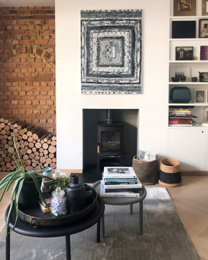 Contemporary art above the fireplace selected by Louisa Warfield Art Consultancy