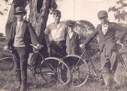 With their bikes, my grandfather centre. Presumably these are brothers -- my grandfather was one of eighteen!