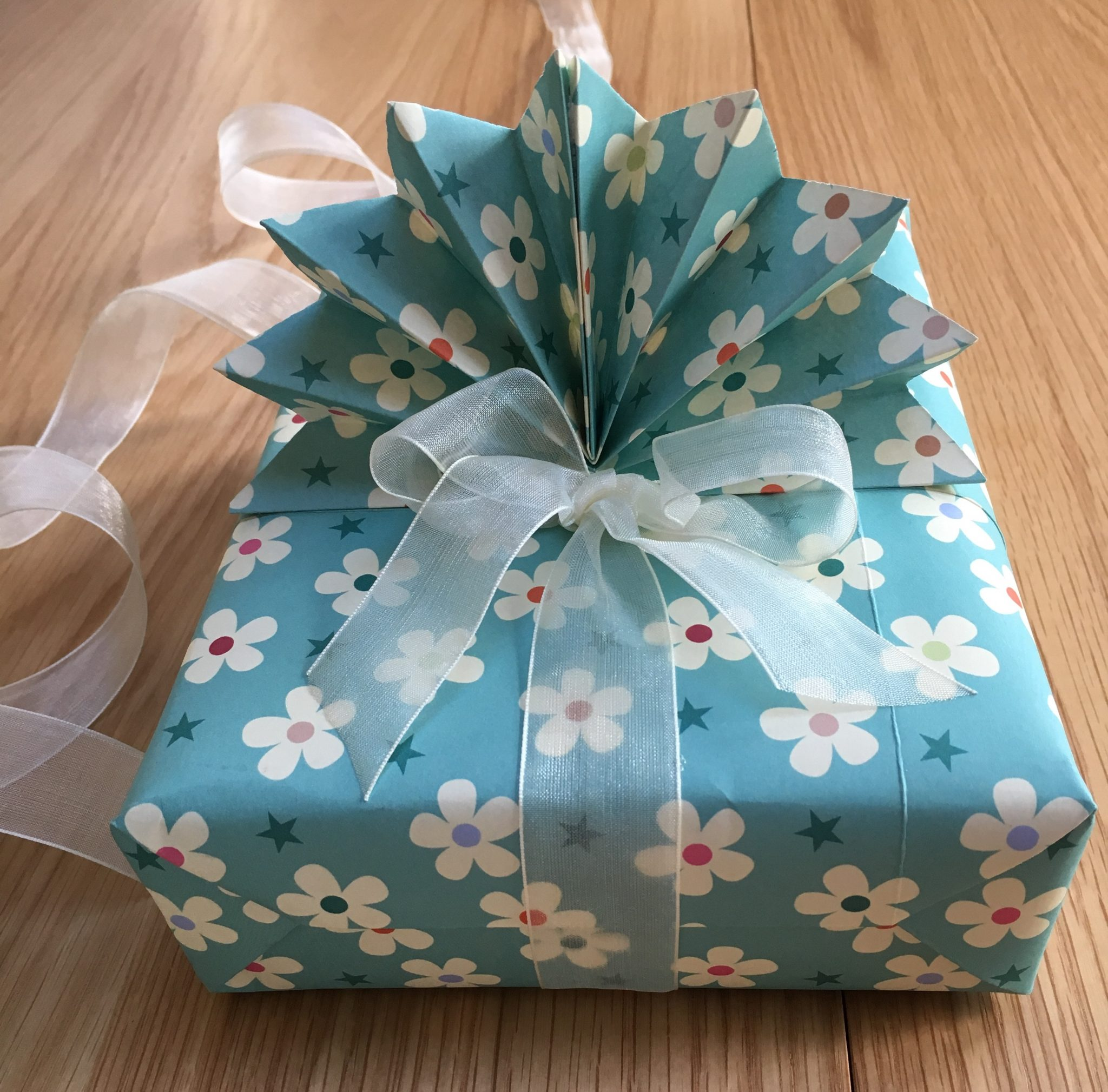 Floral giftwrapped box with a bow & fan decoration