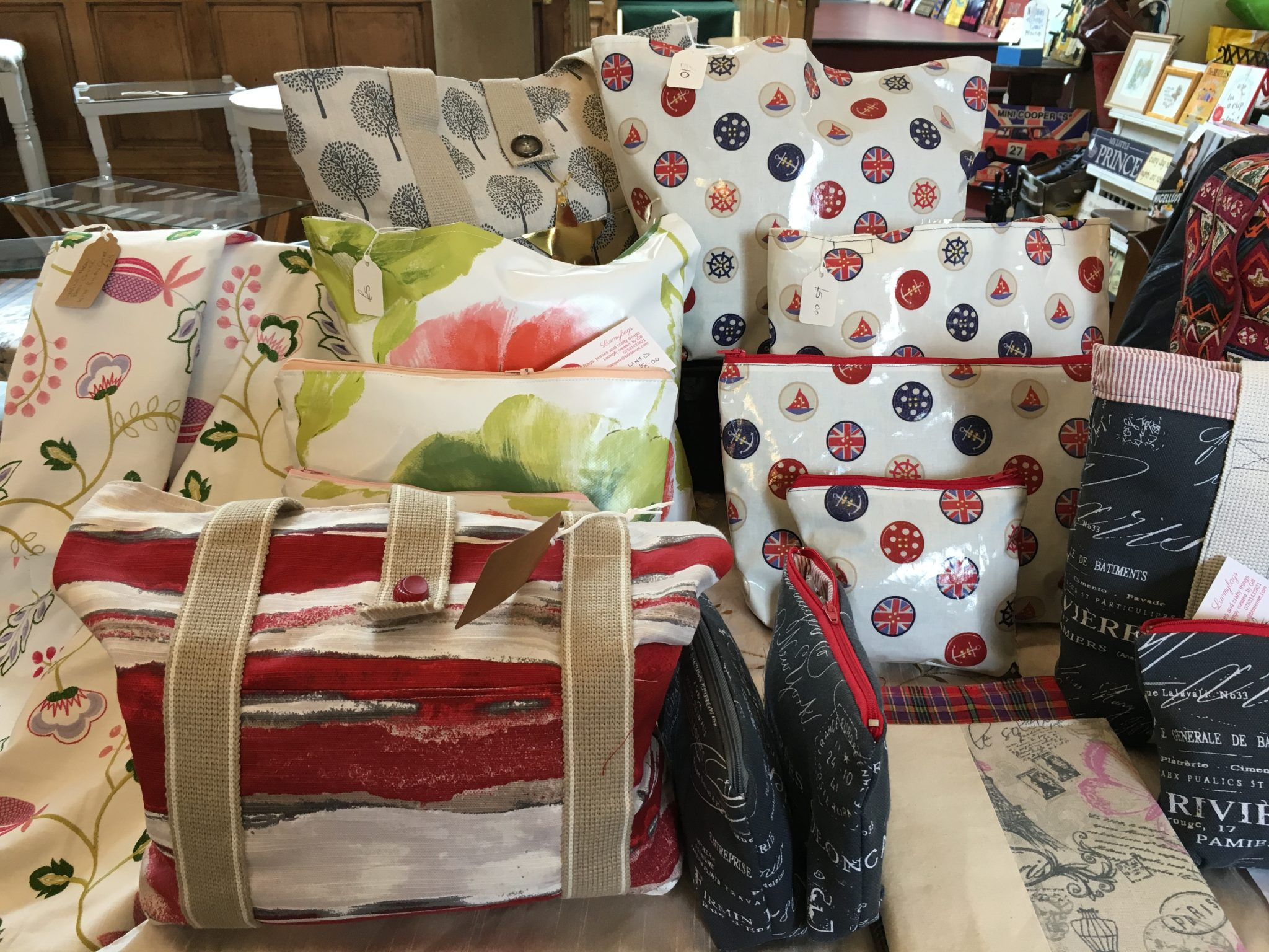 A selection of toilet bags, cosmetic bags and purses in vibrant fabric