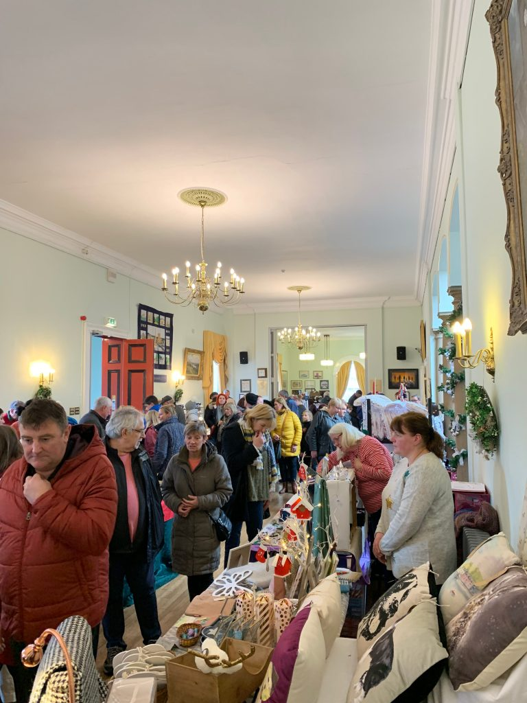 traders and visitor inside the Town Hall at Christmas