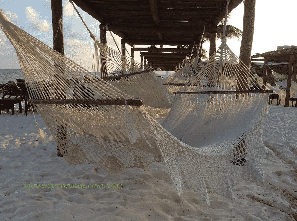 hammocks beckoning on the beach